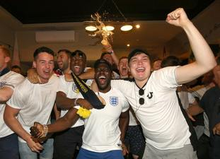 England supporters enjoy the match at the Lord Raglan Pub in London