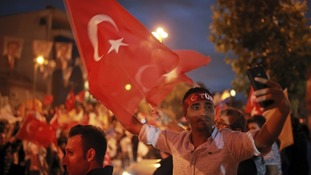 Supporters of Turkey's president celebrate the results