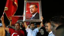 Supporters of Turkey's President Recep Tayyip Erdogan gathered to listen to an earlier victory speech.