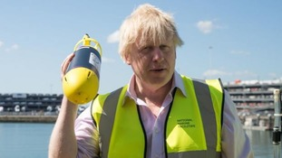 Boris Johnson will be abroad 'as the living embodiment of global Britain' when the vote takes place. (PA)