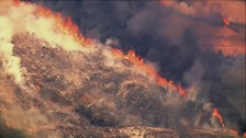 Thousands flee as flames race across California
