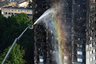Firefighters spray water on Grenfell Tower