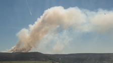 Firefighters are battling against a large moorland fire near Stalybridge