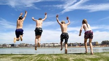 Children enjoy jumping into a sea pool in Margate, Kent