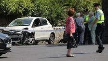 Car crash injures crowd as mourners gather for funeral