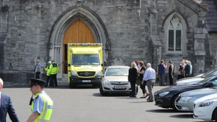 An ambulance in the grounds of the church of the Immaculate Conception in Clondalkin (Niall Carson/PA)