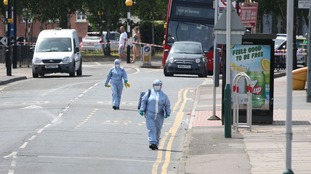 Forensic investigators at the scene of a stabbing in Romford, east London