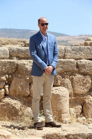 William donned sunglasses amid blazing sunshine