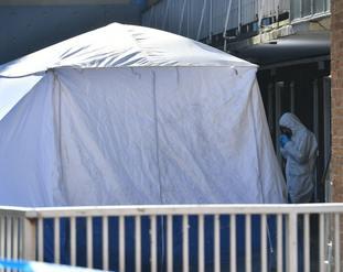 A police crime scene tent on Prewett Street