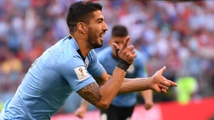 A Suarez free-kick, Cheryshev own goal and late Cavani tap-in was enough for Uruguay to top Group A ahead of Russia
