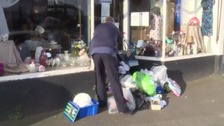 Charities have to deal with rubbish left outside shops