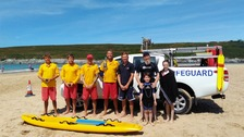 RNLI lifeguards and children