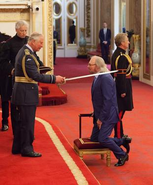 Barry Gibb is knighted by the Prince of Wales
