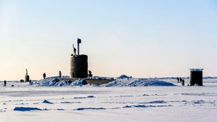 Royal Navy submarine HMS Trenchant after it broke through the ice of the North Pole.