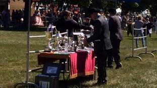 Judges at the Royal Norfolk Show preparing to present livestock prizes.