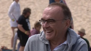Oscar-winning director Danny Boyle on location on Gorleston beach.