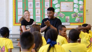 John Boyega makes surprise visit to his old London primary school
