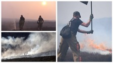 Firefighters tackle the wildfire on Saddleworth Moor.