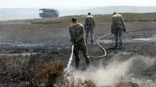 Soldiers help battle the blaze on Saddleworth Moor