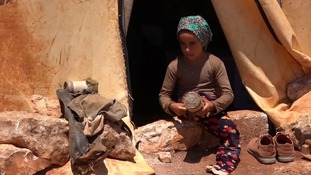 Maya's family fled Aleppo and now live in this tent in northern Syria.