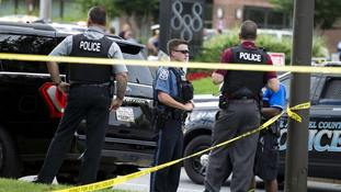 Authorities work the scene after multiple people were shot at a newspaper office building in Annapolis