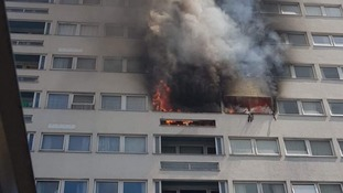 58 firefighters are battling the blaze in East London.