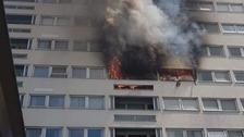 58 firefighters are battling the blaze in East London.