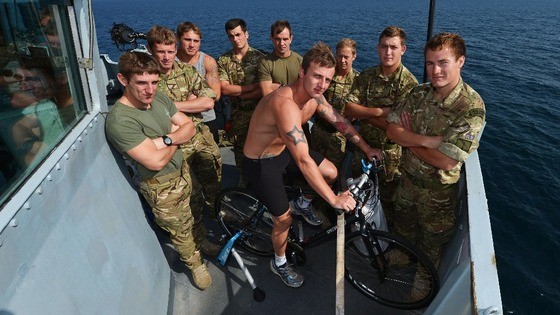 The Marines with their bike on the bridge wing.