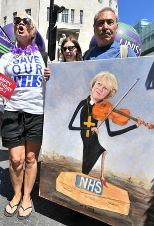 Protesters take aim at Theresa May