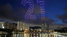 One hundred drones are remote-controlled to form a shape of number 21 in Hong Kong.