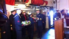 Wreaths are exchanged on board Primauguet