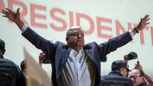 Presidential candidate Andres Manuel Lopez Obrador acknowledges his supporters as he arrives in Mexico City's main square, the Zocalo.