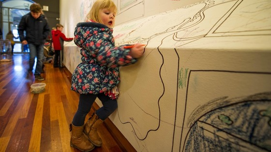 Hannah Skryne, aged three, draws at York Art Gallery