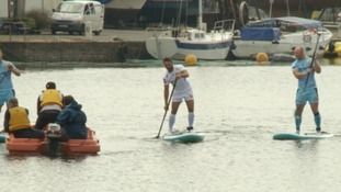 The players arrived by paddleboard