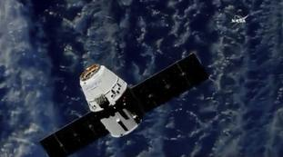 A SpaceX cargo capsule approaches the International Space Station
