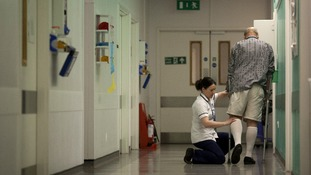 A patient helped by a nurse at Guys Hospital in London in 2011.