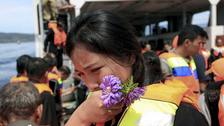 A relative weeps during a prayer for the victims of the ferry that sank on June 18 on Lake Toba, Indonesia.