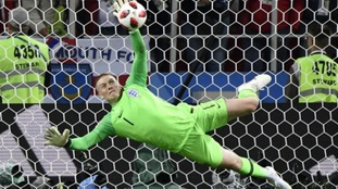 Goalkeeper Jordan Pickford saves a penalty kick by Colombia's Carlos Bacca.