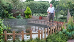 Alan Brown by his pond