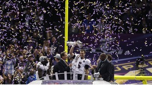 Baltimore Ravens quarterback Joe Flacco raises the Vince Lombardi Trophy.