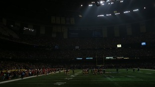 The lights go out during the third quarter of the match, plunging the stadium into darkness.