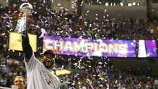 Baltimore Ravens inside linebacker Ray Lewis hoists the Vince Lombardi Trophy as he celebrates victory over the San Francisco 49ers.
