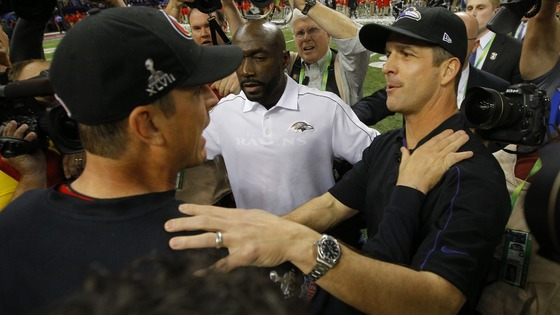 San Francisco 49ers head coach Jim Harbaugh (L) congratulates his brother, Baltimore Ravens head coach John Harbaugh, after the Ravens won.