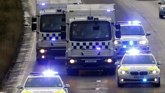 Police vehicles, believed to be carrying Dale Cregan, make their way along the M61 in Bolton towards Preston Crown Court. 