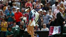 Johanna Konta walks off court after losing to Dominika Cibulkova.