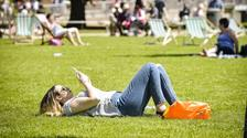 People relax in the sunshine