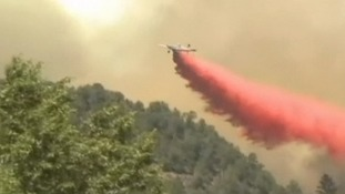 Wildfires rage across Western states of America as extreme temperatures soar