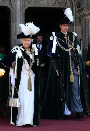 The Queen and the Duke of Cambridge depart the service