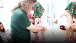 Child fleeing war takes first steps with prosthetic legs thanks to kind-hearted doctor
