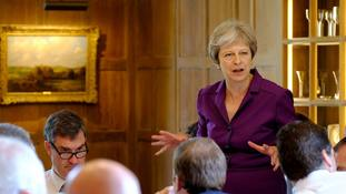 Theresa May hopes the proposals will enable talks with the EU to move forward.